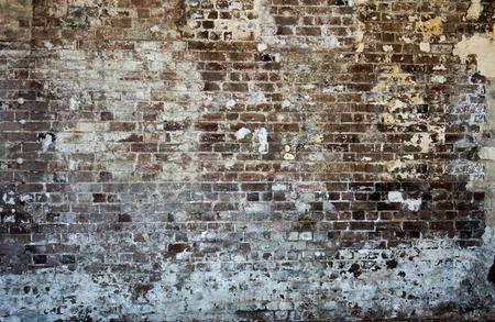 Brick stonewall old worn peeling paint background wallpaper