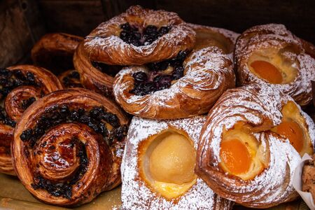 Freshly baked danish pastries, custard, apricots, blueberries, raisins, cinnamon swirl dusted in icing sugar and glaze