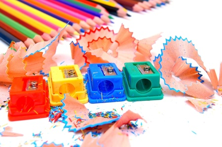 Sharpeners and pencils on a white background. Stock Photo