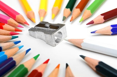 Sharpener and pencils on a white background. photo