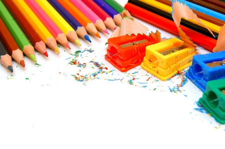 Sharpeners and pencils on a white background Stock Photo - 12651806