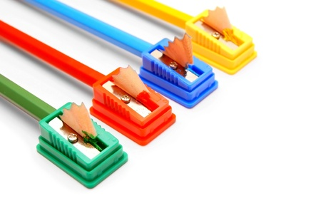 Sharpeners and pencils on a white background  photo