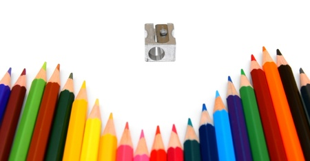 sharpenings: Sharpener and pencils on a white background