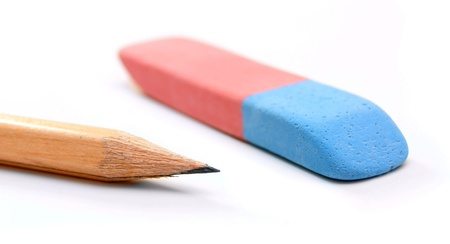 Eraser and pencil on a white background.