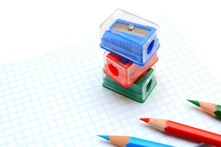 sharpenings: Sharpeners and pencils on a white background. Stock Photo