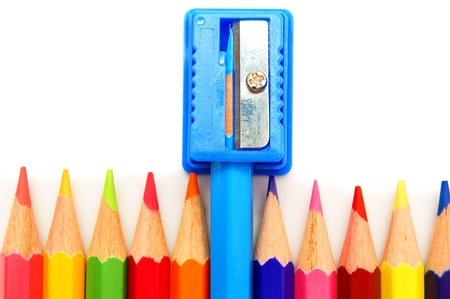 Sharpener and pencils on a white background. Stock Photo