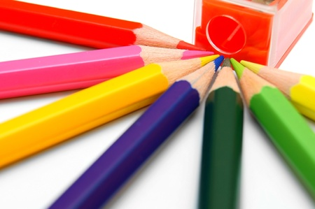 Sharpener and pencils on a white background Stock Photo - 12651817