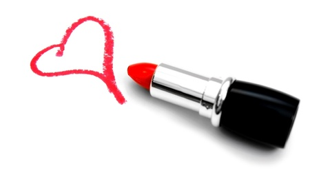 Heart and lipstick  On white background