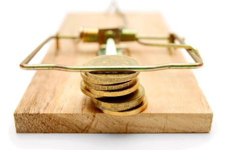 Coins in mousetrap  On white background Stock Photo - 12923411