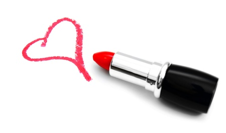 Lipstick for lips and heart  On a white background  photo