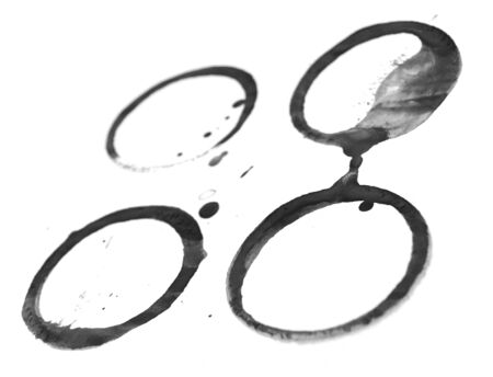 Black stains from cups  On a white background  photo