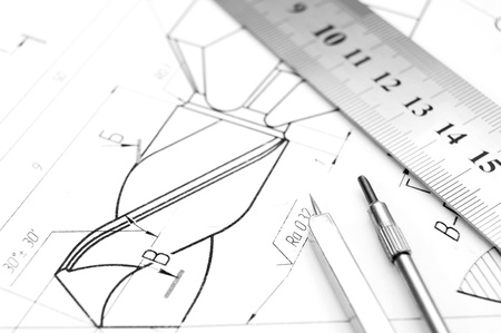 Compasses, ruler and the drawing  photo