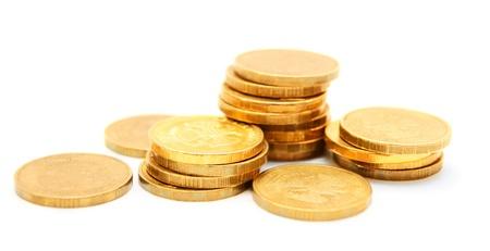 Goldmünzen auf einem weißen Hintergrund Standard-Bild - 13811045
