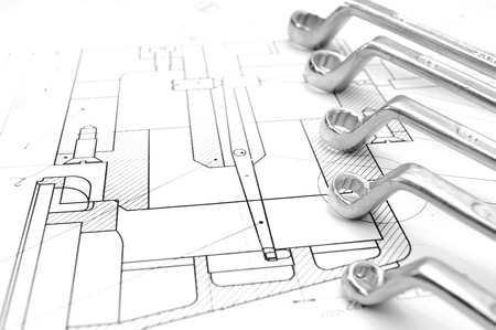 Wrenches on the drawing  Stock Photo