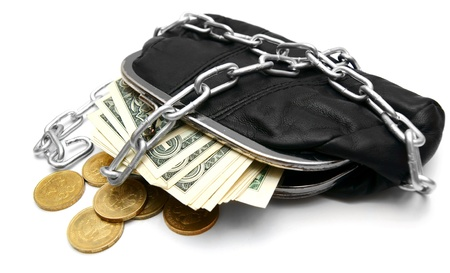 Money, coins and a purse with a chain  On a white background  photo
