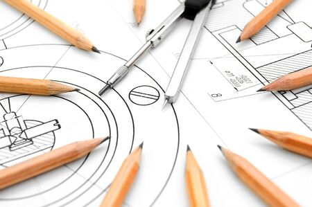 ure: Compasses and pencils on the drawing