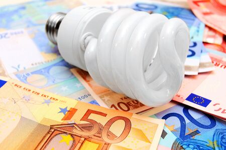 Money and  bulb   On a white background  photo