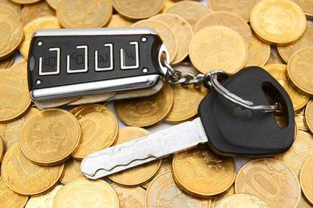 Coins and a key from the car  Stock Photo