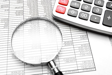 Magnifier, the calculator and documents Stock Photo - 13806900