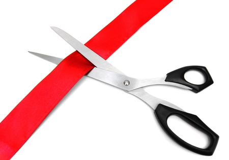 Scissors and red tape  On a white background
