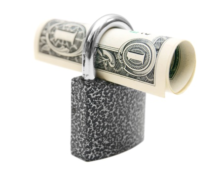 Money and the lock  On a white background  photo