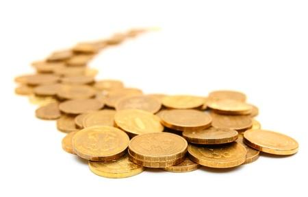 Goldmünzen auf einem weißen Hintergrund Standard-Bild - 13810011