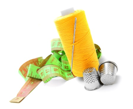Threads, thimbles and a measuring tape  On a white background