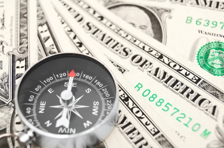Compass and money  On a white background  Stock Photo