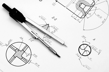 Compasses and the drawing  Stock Photo