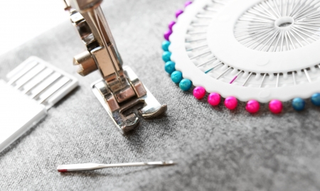 The sewing machine and needles on a fabric