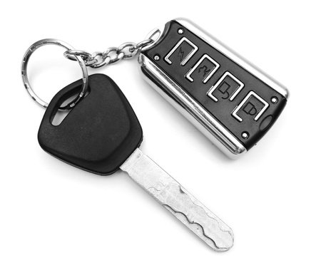 Key from the car and a charm  On a white background  Stock Photo