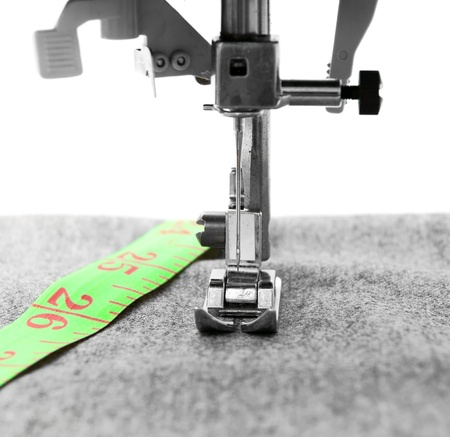 The sewing machine and measuring roulette  photo