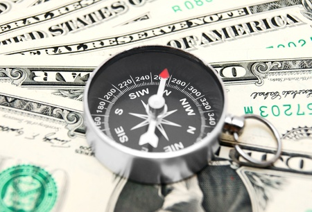 metapher: Money and compass  Stock Photo