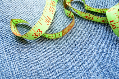 Measuring tape on a fabric  jeans   photo