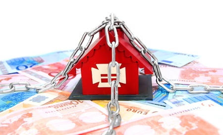 dwelling mound: The toy house, chain and money  On a white background