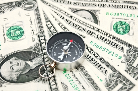 Compass and money  Stock Photo