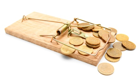 Mousetrap and gold coins  On a white background  photo