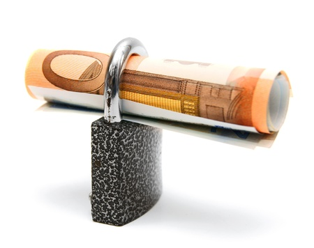 The lock and money  On a white background  photo