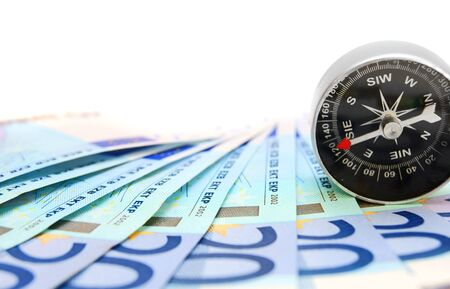 Money and compass  On a white background  Stock Photo