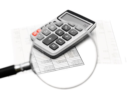 Documents and the calculator through a magnifier
