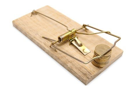 Coins in a mousetrap  On a white background  Stock Photo