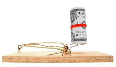Money and mousetrap  On a white background  photo