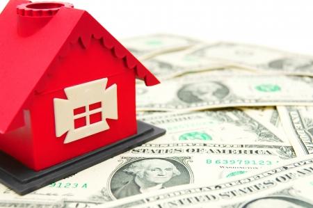 dwelling mound: The toy house on money  On a white background  Stock Photo