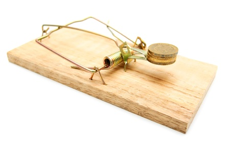Mousetrap and coins  On a white background  photo
