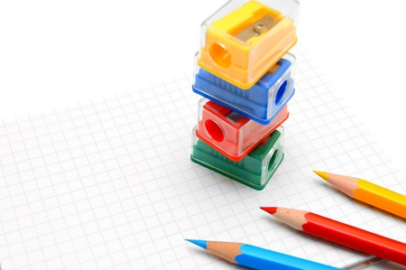 sharpenings: Sharpeners and pencils on a white background