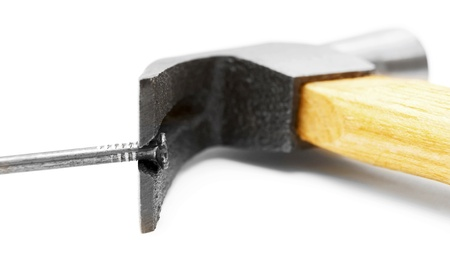 Hammer and nail  On a white background  photo