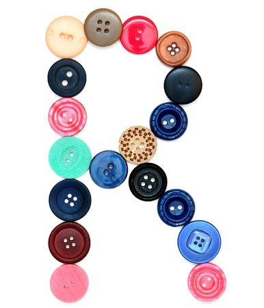 The alphabet from buttons for sewing. On a white background.