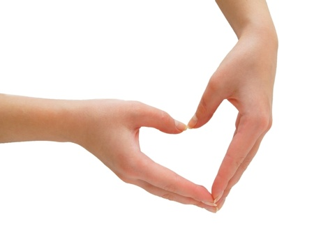 Heart from hands. On a white background. Isolated.
