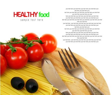 Tomatoes, spaghetti, olives on a wooden board. On white background. There is place for your text. photo