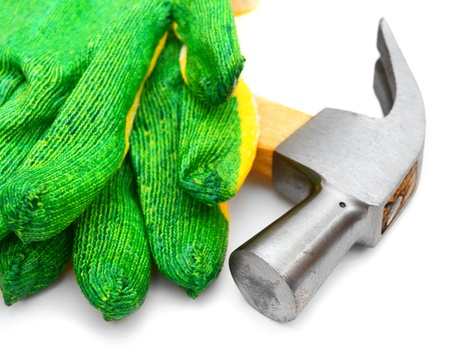 Gloves and a hammer  On a white background